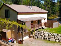 Located just 8.5 miles from downtown Sandpoint, this 3 bedroom / 2.5 bathroom 2892 square foot home  on 5 private acres.